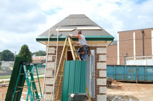 Putting On The Green Metal Roof
