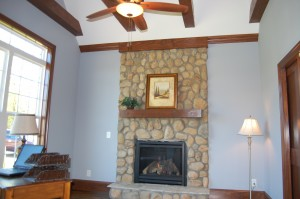 Master's Study River Stone Fireplace Distressed Beam Ceiling