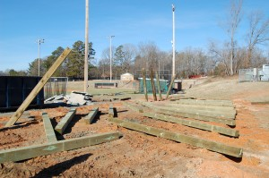 "The 8""x8"" Treated Posts Have Been Laid Next To Their Holes And Are Beginning To Be Raised"