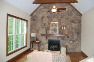 Vaulted Keeping Room Exposed Wood Beams Stone Accent Well With Direct Vent Fireplace