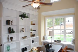 Vaulted Library Custom Bookshelves and Window Seat
