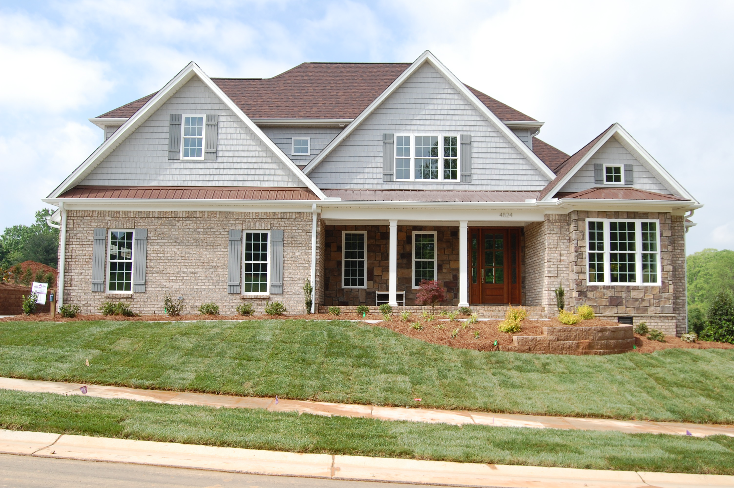 Coffered ceiling and stone fireplace vaulted keeping room with - Arena Builders Award Winning Custom Home Builders